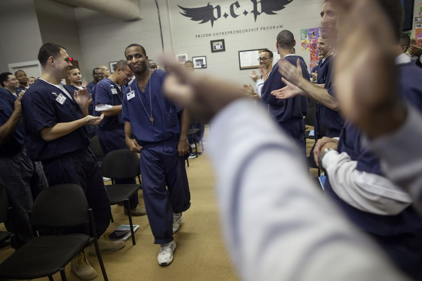 """Brandon Biko Reese, who will soon be released after serving a five-year sentence, is enthusiastically welcomed to the front of the room to give a farewell speech. In an effort to """"de-gangsterize"""" inmates, administrators encourage them to dance and cheer for their peers whenever possible."""