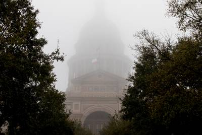 Dense fog blankets the dome of the Capitol in Austin.