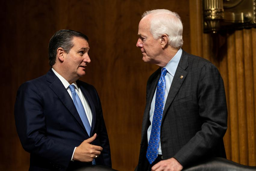 From left, Senators Ted Cruz and John Cornyn talk as Judge Brett Kavanaugh testifies in front of the Senate Judiciary comm...