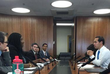 Senior Adviser Maya Rupert at a meeting with Housing Secretary Julian Castro.