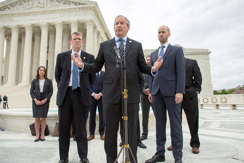Texas Attorney General Ken Paxton, center, speaks on the steps of the U.S. Supreme Court with his team, including Texas So...
