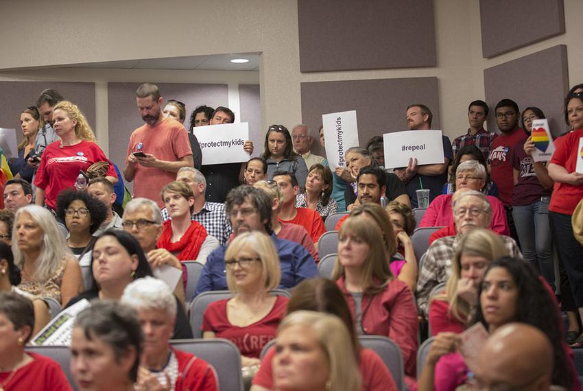 Opponents and supporters of the Fort Worth Independent School District's guidelines for transgender children pack a school b…