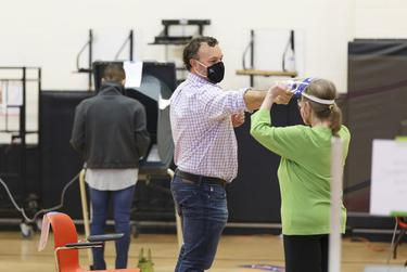 Poll workers get their temperature checked at the Metropolitan Multi-Services Center in Houston on Nov. 3, 2020.