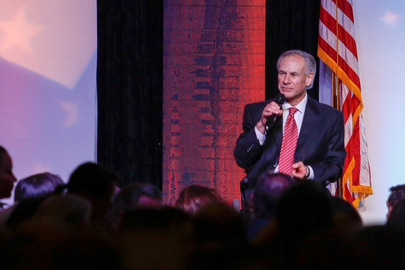 Gov. Greg Abbott is shown on stage on Feb 24, 2016, in Houston during the Harris County Republican Party's 2016 Lincoln Reagan dinner.
