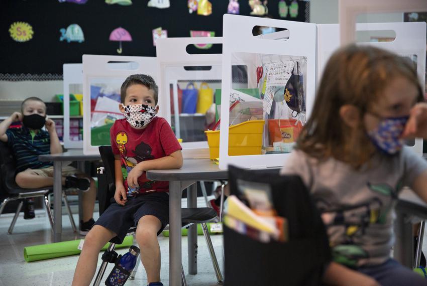 Declan True listens to kindergarten teacher Mrs. Hogan on the first day of in-person classes at Highland Village Elementary …