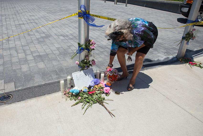 Clara Brown Trimble, 63, put flowers next to a small memorial to police officers killed by sniper fire the night before in...