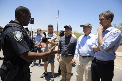 U.S. Rep. Joaquin Castro, D-San Antonio; U.S. Sen. Tom Udall, D-New Mexico; and U.S. Rep. Beto O'Rourke, D-El Paso, get instructions prior to touring the tent city at Tornillo Port of Entry.