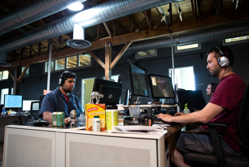 Naveen Nattam (l) Sean Riley (r) play games during their lunch break at Twisted Pixel, a video game company in Austin. Texas…