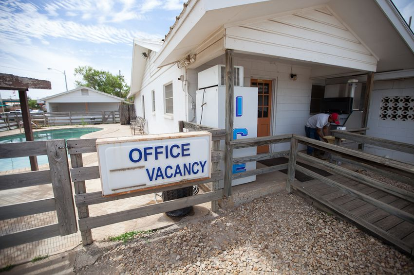 Cotulla Motel employee Jared Ramirez bags ice on April 7, 2016. Ramirez began working at the motel after work in the oil fields dried up.