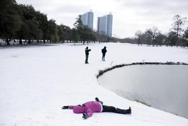 Mia Natali does snow angels at Hermann Park in Houston on Feb. 15, 2021.