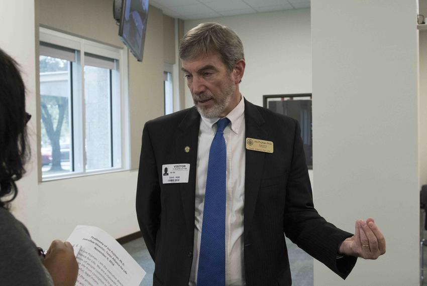 Joe Pojman, executive director of Texas Alliance for Life, speaks to a reporter at the Department of State Health Services...