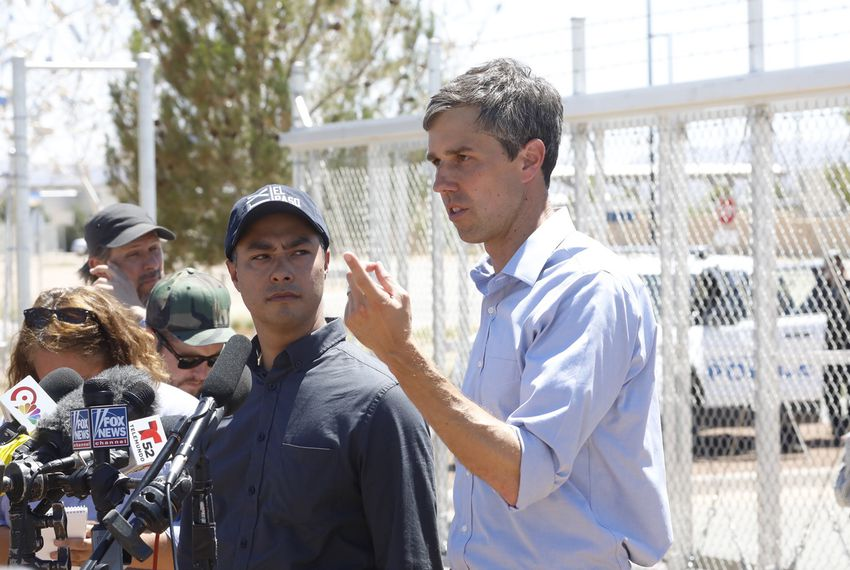 U.S. Rep. Joaquin Castro, D-San Antonio, listens as Rep. Beto O'Rourke, D-El Paso, speaks at a press conference after touring the tent city at the Tornillo port of entry on June 23, 2018.