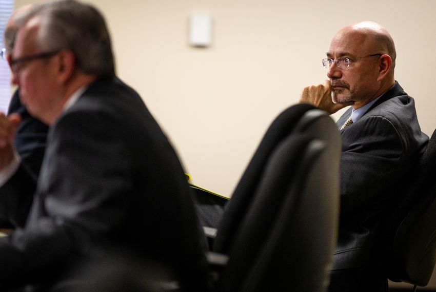 Michael Feinberg, right, watches as his lawyers defend him at a hearing in Austin to determine whether he should surrender his teaching license to the Texas Education Agency.
