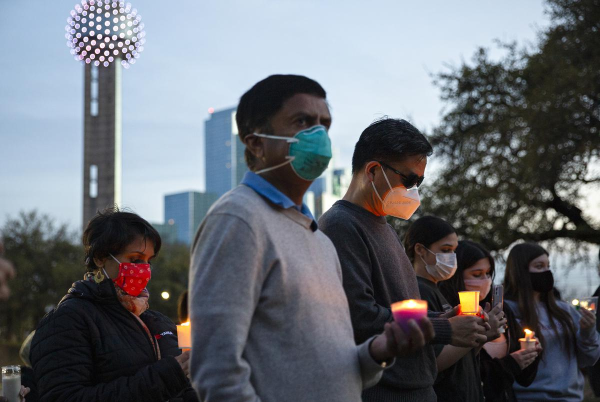 People gathered at the Grassy Knoll in Dallas to stand in solidarity with the Asian community and to honor the victims of the recent shootings in Atlanta.