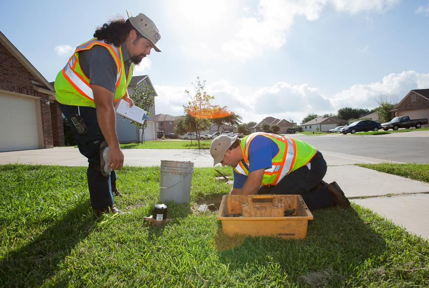 Utility workers in Round Rock install a new electronic water meter intended to save water and lower the costs for consumers.