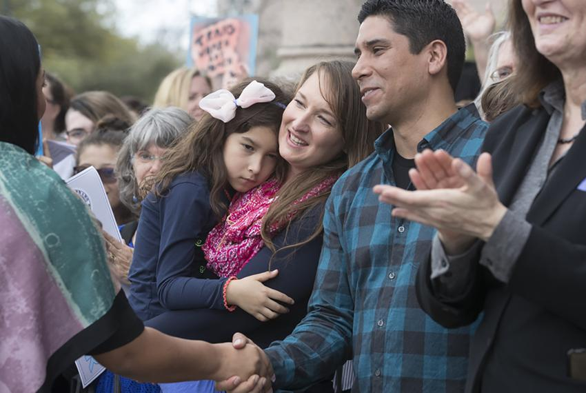 Frank Gonzales (center right), Rachel Gonzales (center) and their daughter Libby attend a rally during Texas Trans Lobby Day…