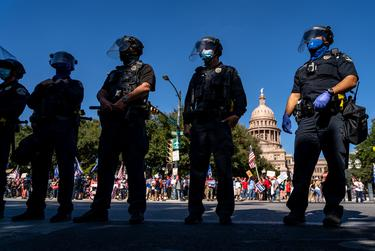 Austin Police Department officers in riot gear showed up at the Texas State Capitol as dueling rallies develop for President Donald Trump and President-Elect Joe Biden.