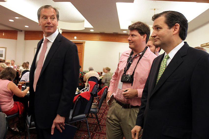 Lt. Gov. David Dewhurst and Ted Cruz, who are competing in a run-off for U.S. Senate, speak to reporters before talking at the Republican Women of Kerr County luncheon at Inn of the Hills in Kerrville, June 15, 2012.