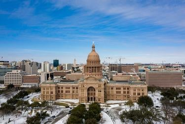 The Texas Capitol grounds are covered in snow on Feb. 16, 2021.