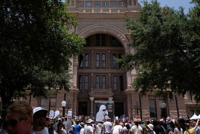 Thousands of demonstrators gathered at the Texas State Capitol awaiting speakers in Austin.