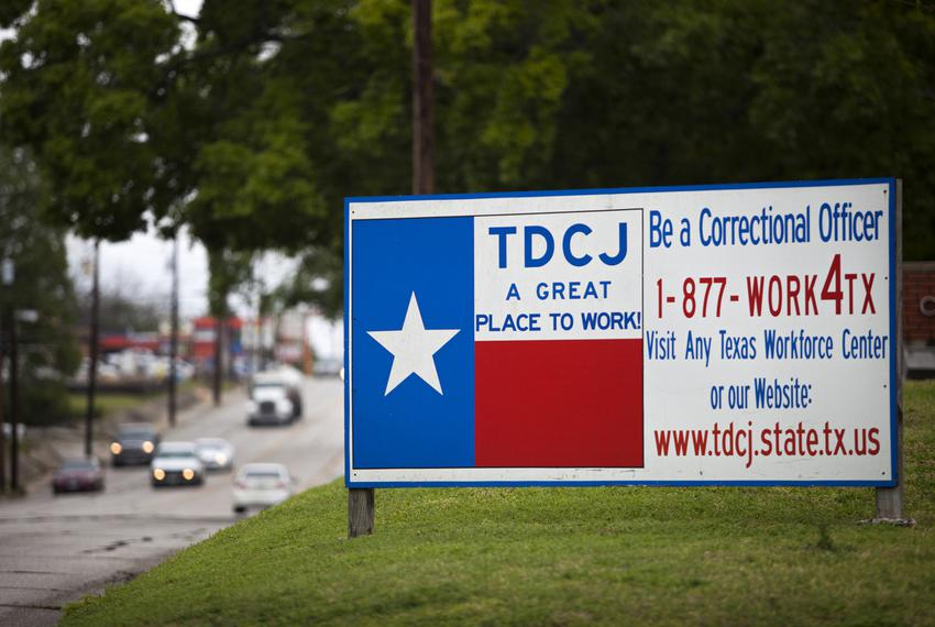 A sign outside of the Texas Department of Criminal Justice Headquarters in Huntsville. Last year, Texas prison officials app…
