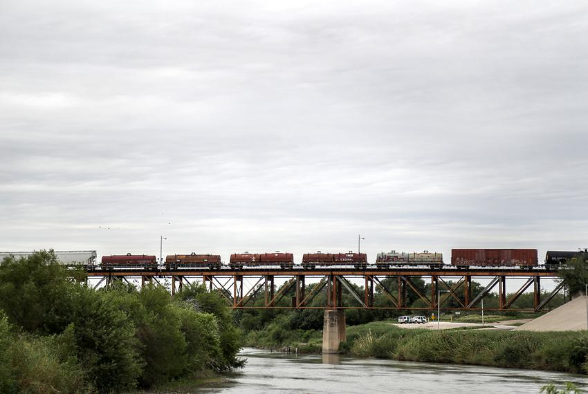 Freight trains cross the Rio Grande river near the Laredo Convent Avenue Port of Entry between Laredo and Nuevo Laredo.