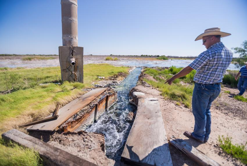 Ty Edwards, assistant general manager of the Middle Pecos Groundwater Conservation District, points to brackish water flowin…