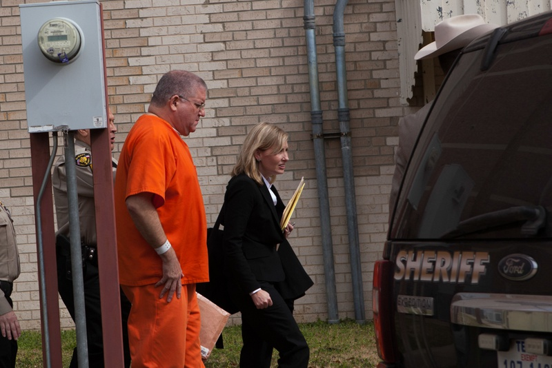 """Bernhardt """"Bernie"""" Tiede exits the Panola County Court building with his attorney Jodi Cole after his hearing on Feb. 5, 2014 in Carthage. A state district judge agreed to release Tiede in May, 17 years into his life sentence."""
