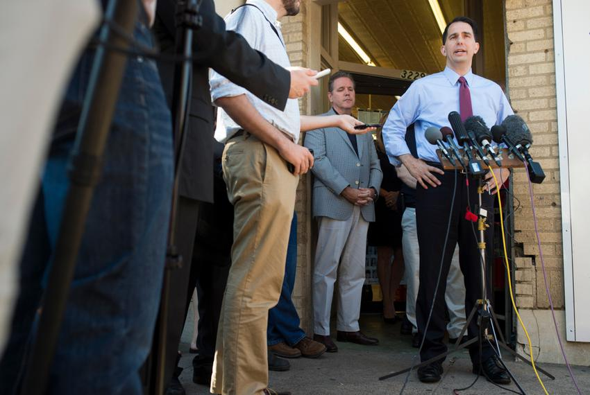 Republican presidential candidate Wisconsin Gov. Scott Walker visits with supporters at the Highland Park Soda Fountain in D…