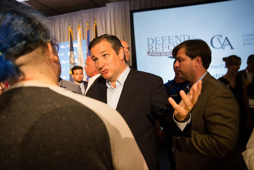 U.S. Sen. Ted Cruz speaks to a member of the audience at a town hall event hosted by a group called Concerned Veterans for America in Austin on July 6, 2017.