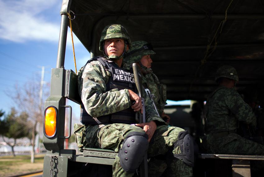 A soldier is seen in the back of a transport truck in Ciudad Juárez on Feb. 15, a few feet from where Pope Francis celebrate…