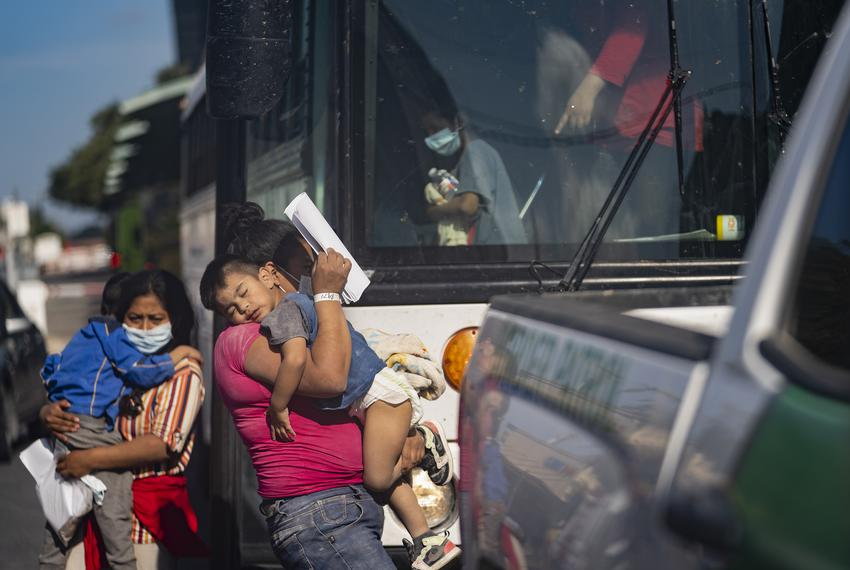 Asylum seekers disembark a bus in front of Catholic Charities Humanitarian Respite Center in McAllen on Aug. 2, 2021.