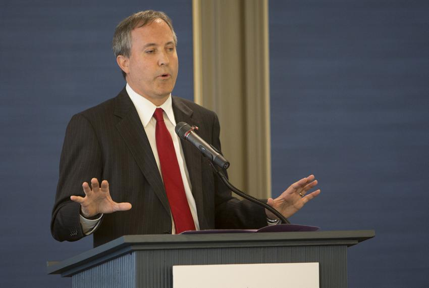 Texas Attorney General Ken Paxton speaking at the Texas Public Policy Foundation's opening of its new building on April 21, …