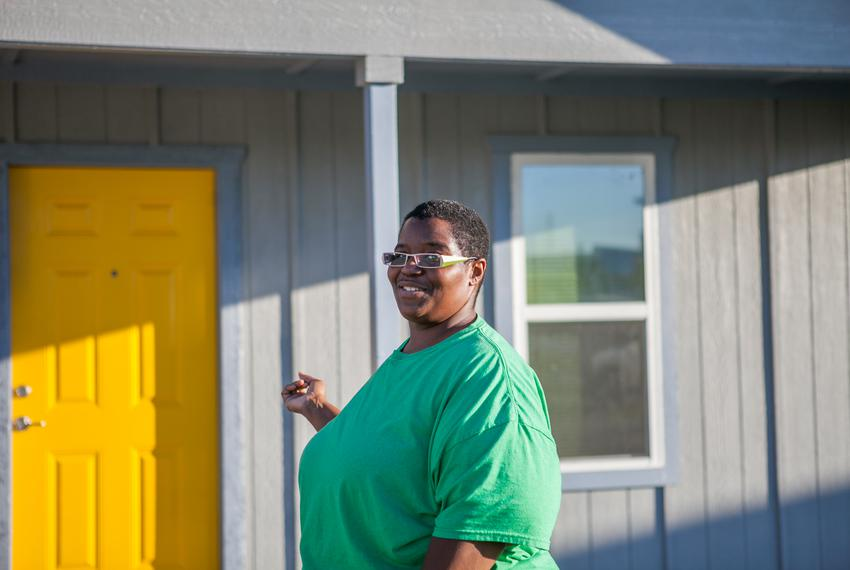 Sharon Jones, 38, outside her new home in east Austin. Before building her house, she received Section 8 housing aid for 10 …