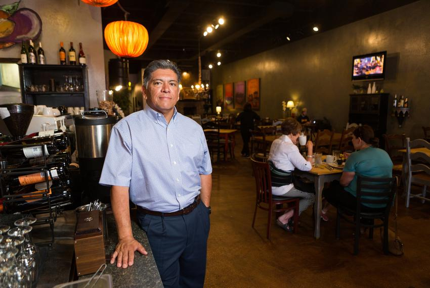 Mayor Jerry Morales stands by the counter in Mulberry Cafe, which he bought months after oil prices tanked. The Midland nati…