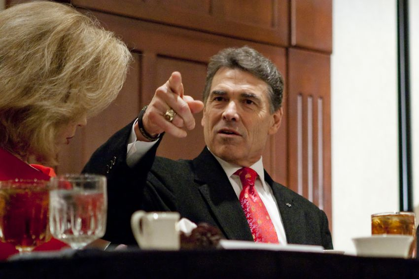 Gov. Rick Perry with wife Anita at a Williamson County Republican dinner in Round Rock, his first public appearance since leaving the presidential race.