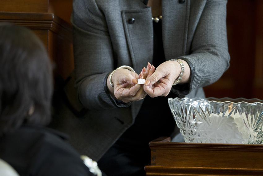 Sen. Leticia Van de Putte, D-San Antonio, is shown her lottery number by Senate Secretary Patsy Spaw on Jan. 23, 2013.