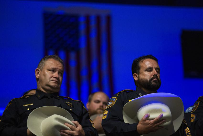 Police officers at a service held for Deputy Sandeep Dhaliwal of the Harris County Sheriff's Office. Dhaliwal was shot and k…