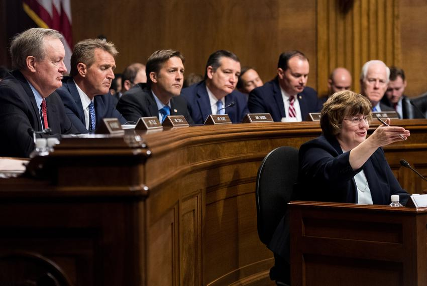 Rachel Mitchell, counsel for Senate Judiciary Committee Republicans, questions Christine Blasey Ford as Sens. Mike Crapo, ...