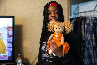 Dabry Dugay, 17, holds her doll Austina that was salvaged from Hurricane Harvey wreckage. Dugay, an athlete and musician in school, lost a grand piano, several keyboards and a guitar during the flood.