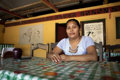 """""""A year ago, we didn't have enough space for everyone,"""" says Marixa Garcia Ramos, a cook at the Cepi Pollo restaurant and hotel. Now she worries the restaurant will have to shut down."""