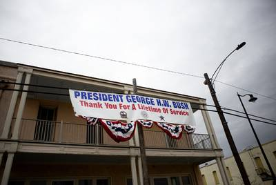 A banner thanking former President George H.W. Bush was draped near downtown Navasota on Thursday. The funeral train carrying the president's remains passed through town on its way to College Station.