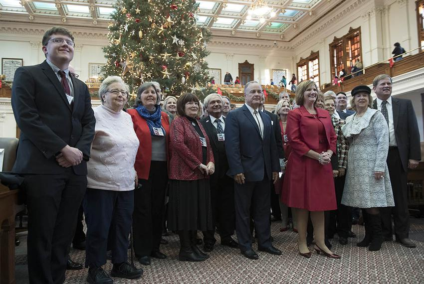Electoral College members pose in front of the Capitol Christmas tree after completing their business at the Texas Capitol...
