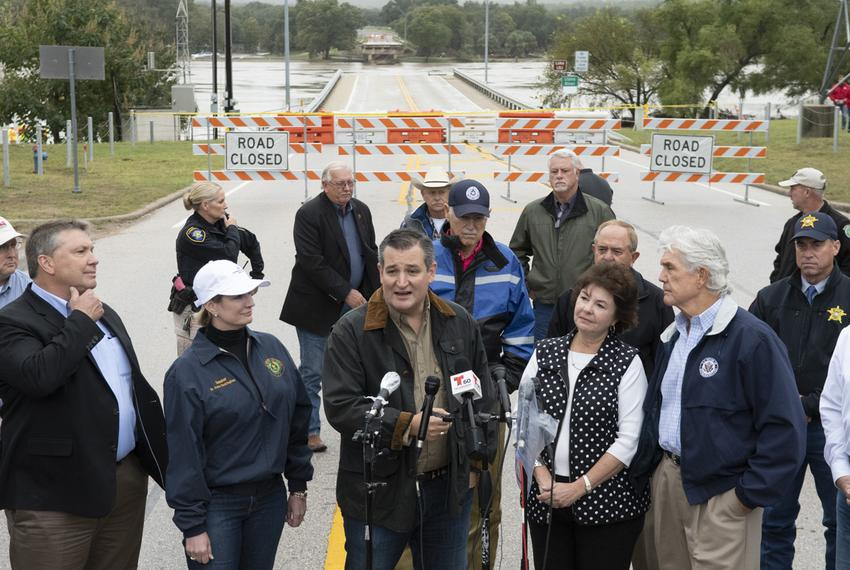 U.S. Sen Ted Cruz speaks as he views a washed out highway bridge during a tour of the Texas Hill Country on Oct. 17, 2018 …