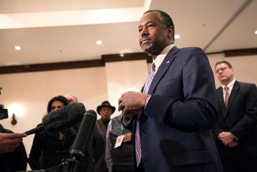 Ben Carson, neurosurgeon and Republican presidential hopeful, speaks with the press after a campaign event in Irving on Feb. 27, 2016.