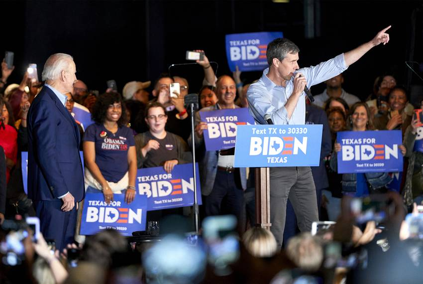Democratic presidential candidate Joe Biden looks on as former candidate Beto O'Rourke speaks at a rally in Dallas on Mond...