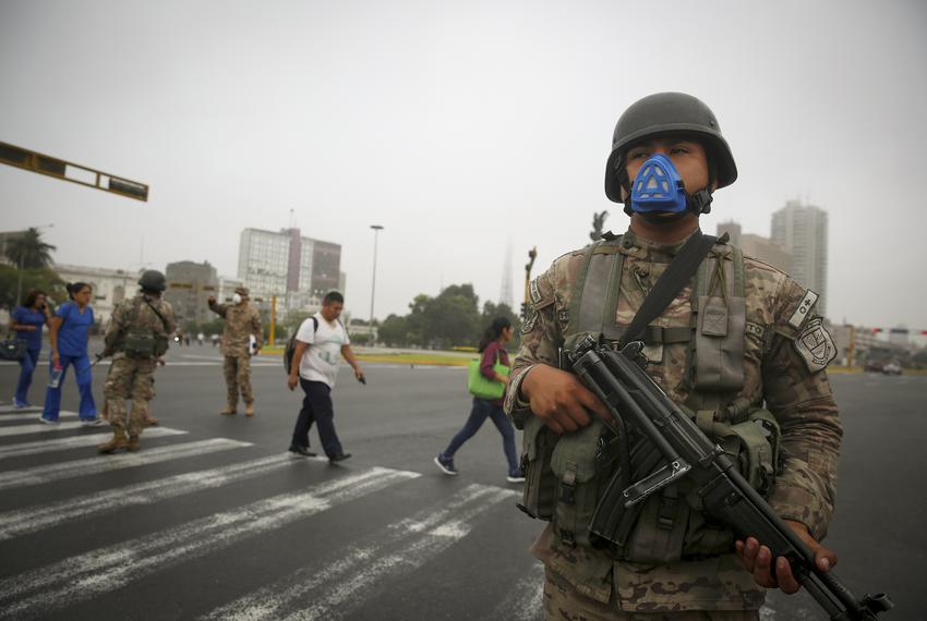 A soldier keeps watch in Lima after Peru's government deployed  the military to block major roads, as the country rolled out…