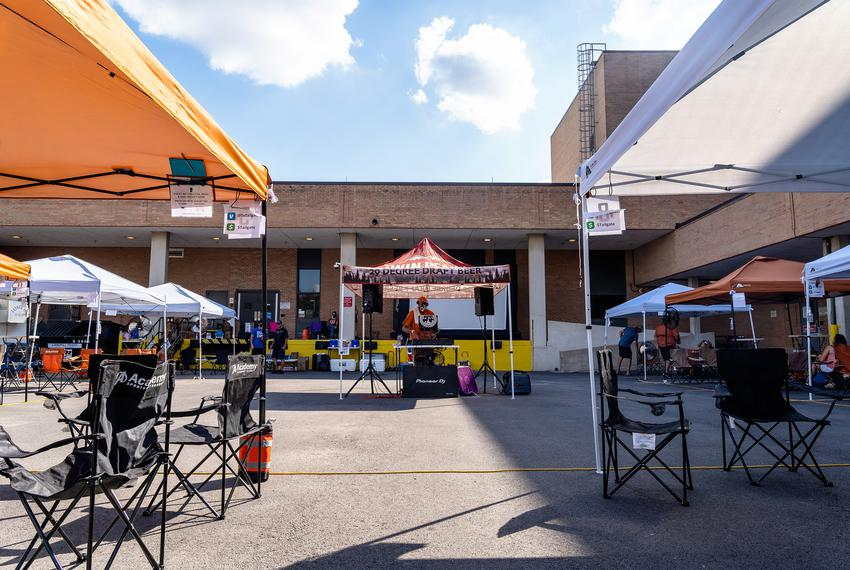 A DJ plays to a small crowd at a tailgate event for the University of Texas football home opener against UTEP on Sept. 12,...