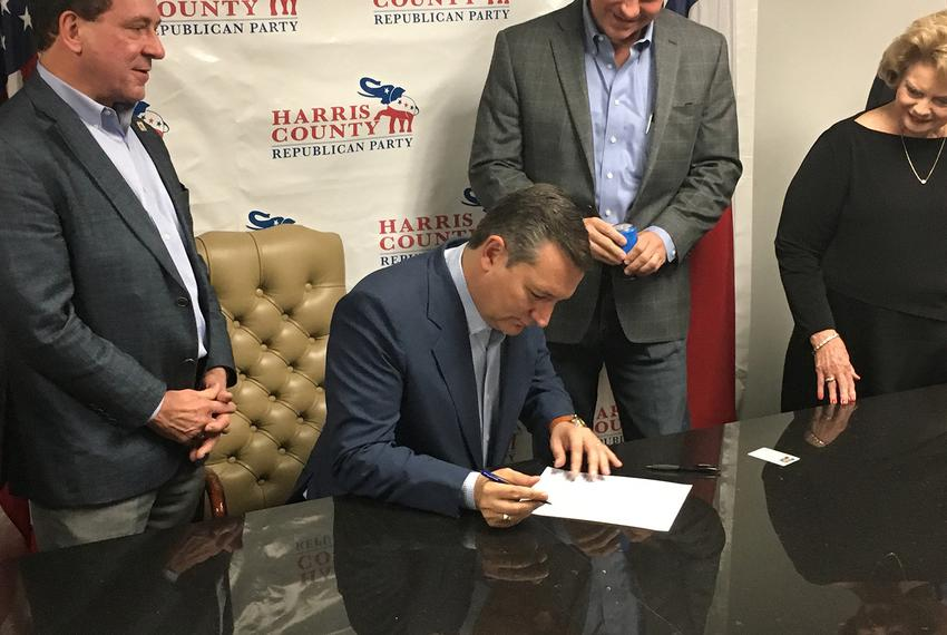 U.S. Sen. Ted Cruz, R-Texas, signs paperwork to file for re-election at the Harris County GOP headquarters in Houston on Dec…