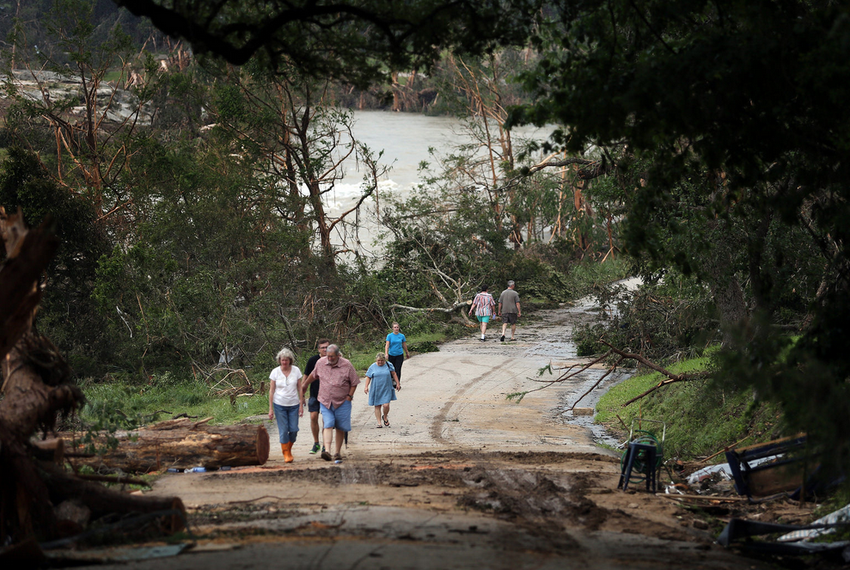 Residents of Wimberley survey the devastation after the Blanco River crested its banks along River Road in Wimberley on Ma...